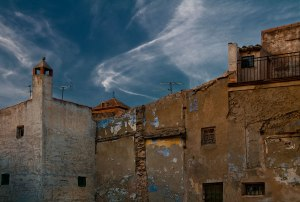 Old town backstreet....Who stapled clouds to the wall?